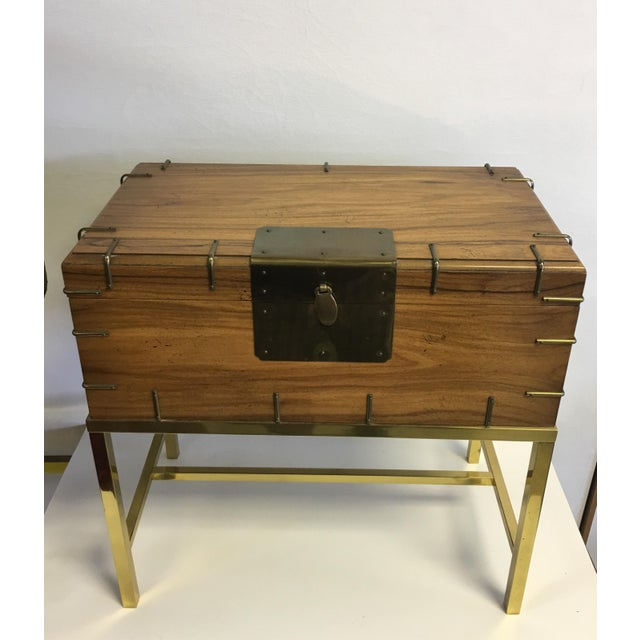Mid Century blond wood and brass box. Beautiful square brass tubbing base. Very versatile piece, great for storing remote...