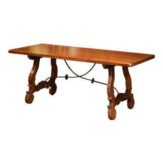Early 20th Century Spanish Carved Walnut Trestle Table and Forged Iron Stretcher For Sale