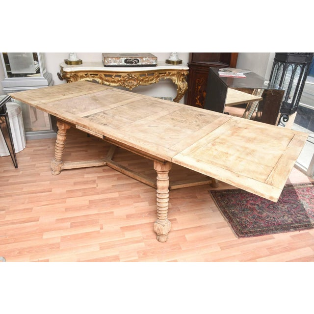 "1900's draw leaf, continental bleached out oak dining table, seating ten fully opened. Closed length 58 1/2"". Each draw..."