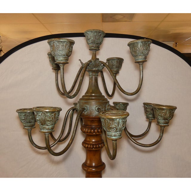 Maitland Smith carved wood and bronze candelabra torchiere. Features 12 beautifully patinaed bronze candle holders with an...