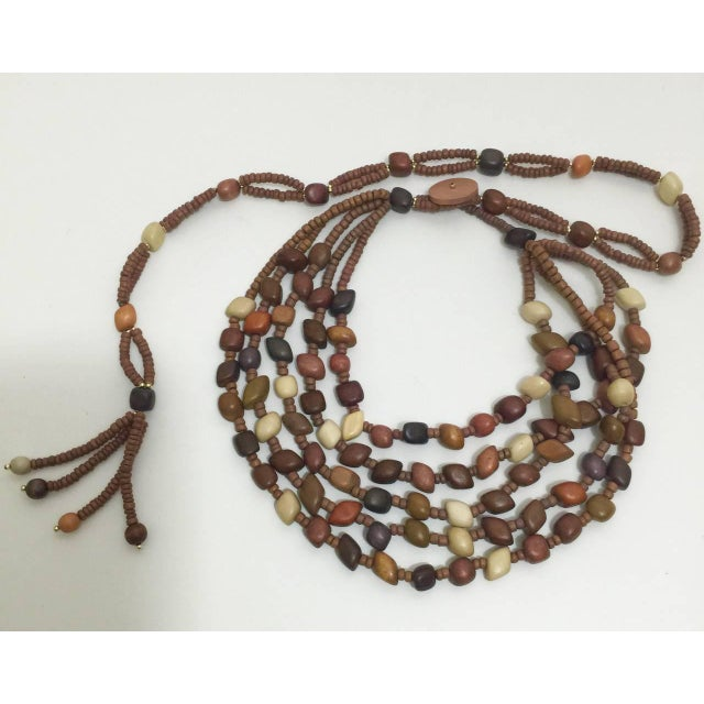 A vintage wood beads adjustable necklace and belt. Excellent condition. Measurements for waist: 24-30 inches Due to the...
