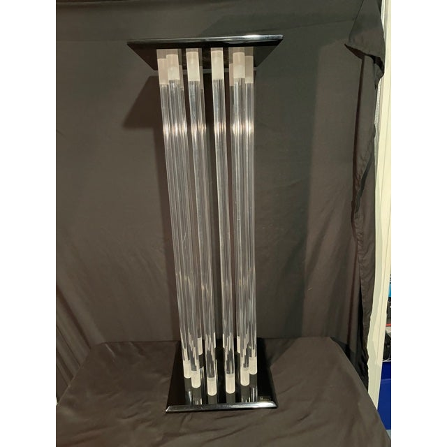A mid-century masterpiece from Shlomi Haziza. This is a one of a kind black and clear acrylic pedestal out of a large...