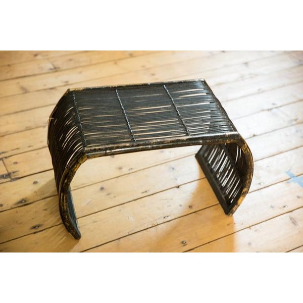 :: Vintage circa 1970s bamboo foot stool / ottoman with chippy black paint, and great squared corner with curvy leg form.