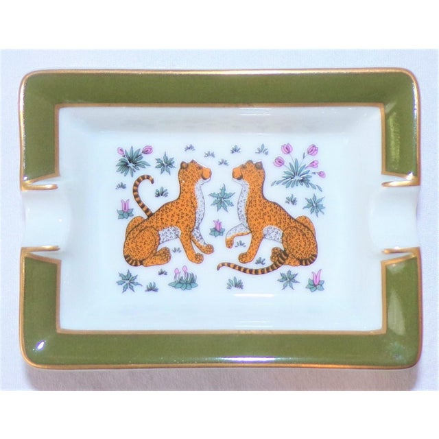 "This is a stunning beautiful porcelain ashtray by Hermes, made in France. This is the Hermes classic ""Les Leopards"" or two..."