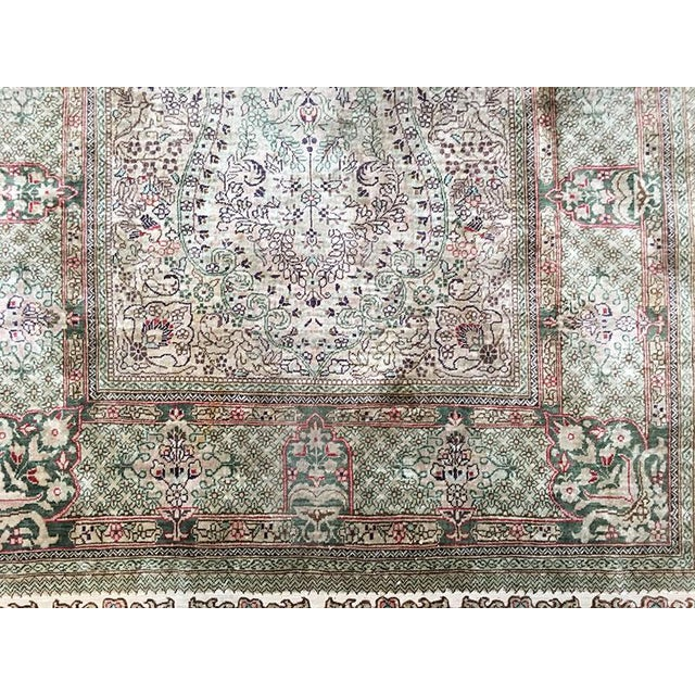 This is a superb 100% silk all the way. weft, warp, and pile. It has almost 600 KPSI. This was hand knotted in China, it...