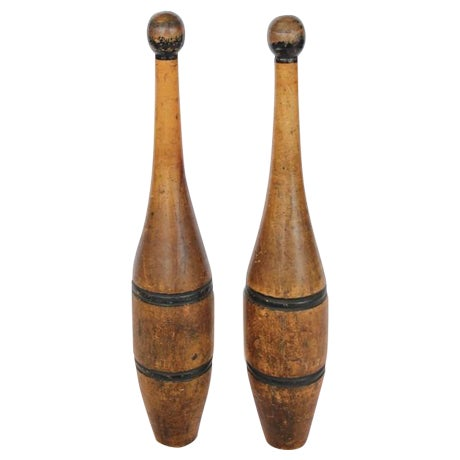 """Antique hand-painted wooden juggling pins and dumbbells. Measures: Juggling pin: H 19"""", W 3.5"""". Dumbbells: H 3.5"""", L..."""