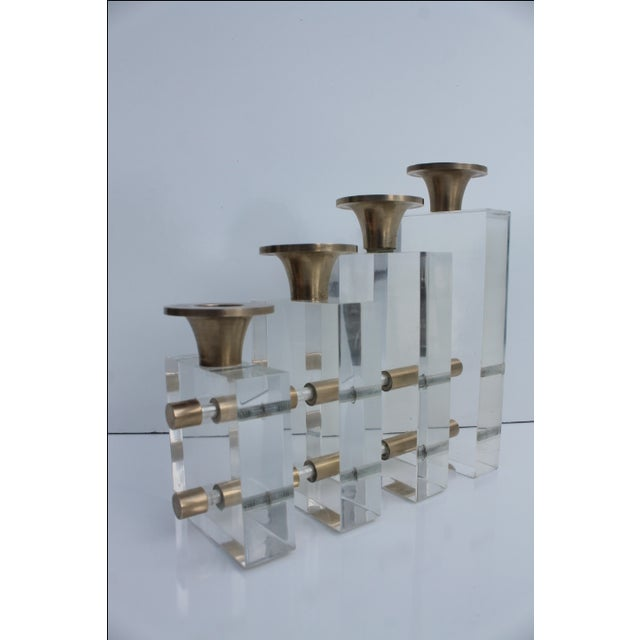 Karl Springer style Glamour lucite and brass polished stacking graduated candleholder. Each piece of lucite is one inch...