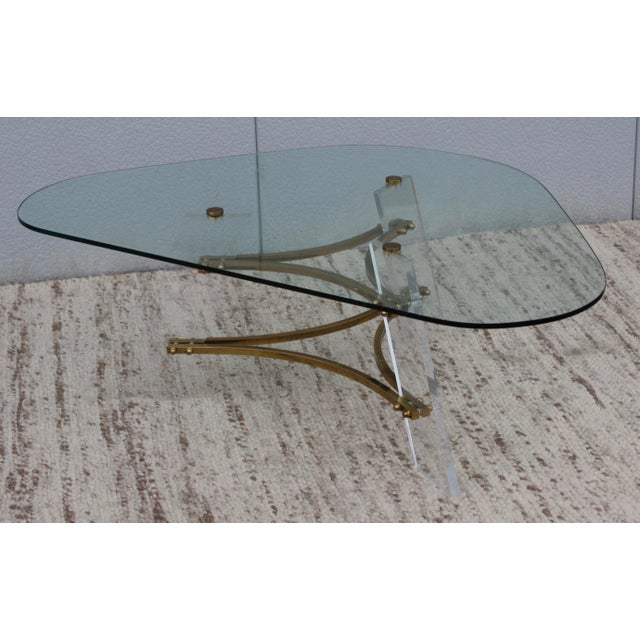 1960's Charles Hollis Jones Brass and Lucite base with glass top coffee table, in vintage original condition with some...