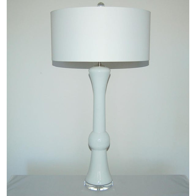 Towering pair of vintage Murano glass table lamps of WHITE cased glass. An inner core of white glass gives them their...
