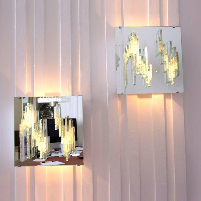 Set of two great wall sconces by the Dutch lighting manufacturer RAAK. Glass elements on a mirror base. Light comes...