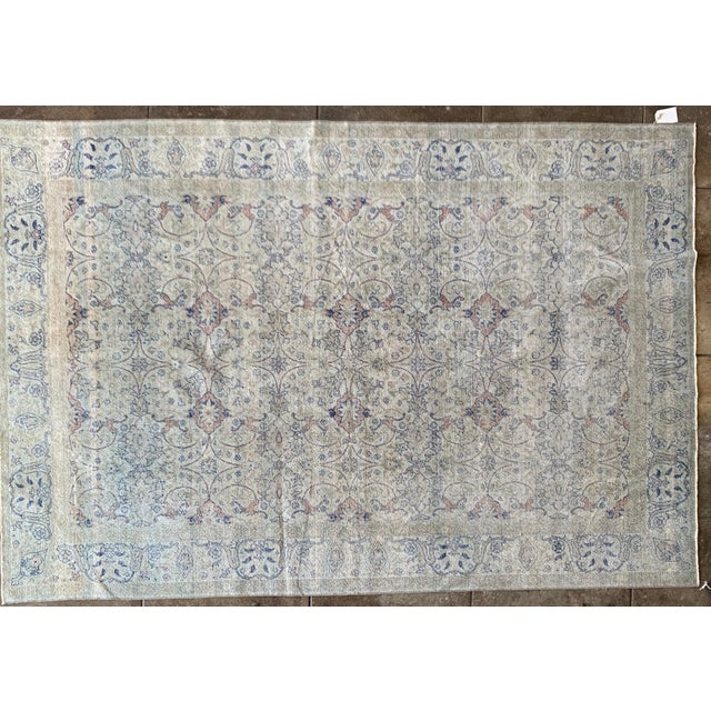 Intricate hand woven persianrug with faded neutral tones. Light background has unique depth and variation.Paris find.
