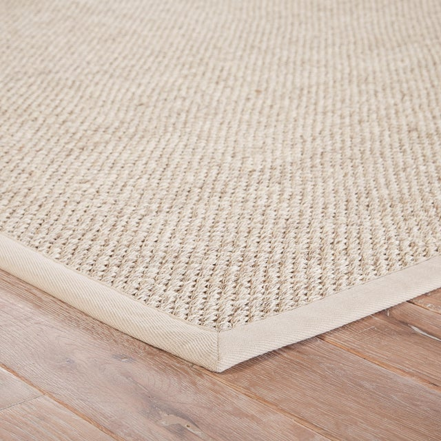 Versatile and organic in the same moment, this natural area rug lends the perfect foundation to coastal and global-style...