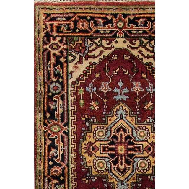 Modern hand-knotted Indo Serapi rug with a multi-medallion design. This piece is in excellent condition and it would be...