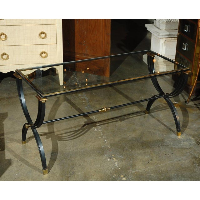 Iron and brass French cocktail table attributed to Raymond Subes. Good vintage condition, age commensurate.
