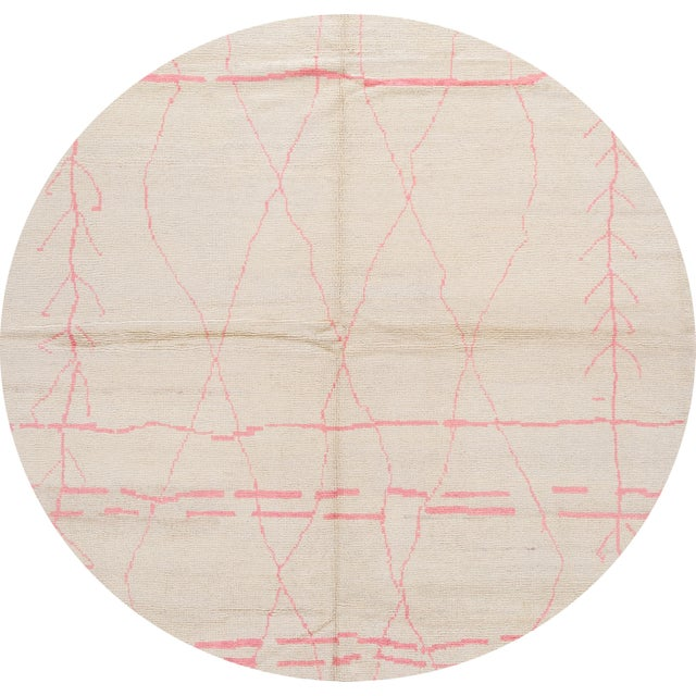 Beautiful Moroccan-style rug, hand-knotted wool with an ivory field, pink accents in a gorgeous all-over tribal design....