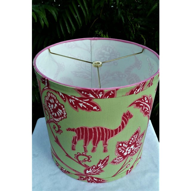 """Fabric and Trim Bright green, hot pink, and white Thibaut """"Batik"""" upholstery fabric. Top and bottom wiring is wrapped with..."""