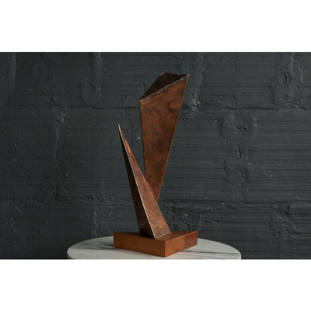 C. 1970s hand hammered copper sheets formed into shapes. Mounted on teak base.
