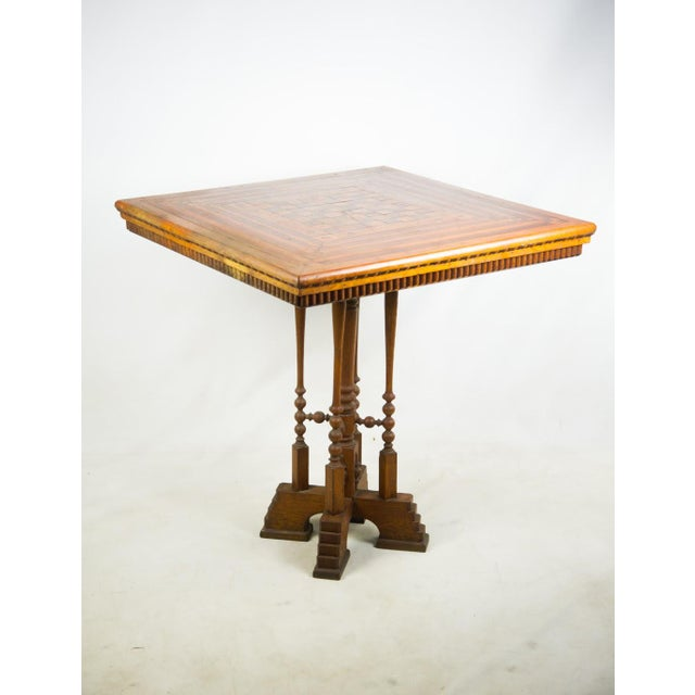 This classy late 19th c. Victorian game table reminds us what fun was like in simpler times. The Victorian style legs will...