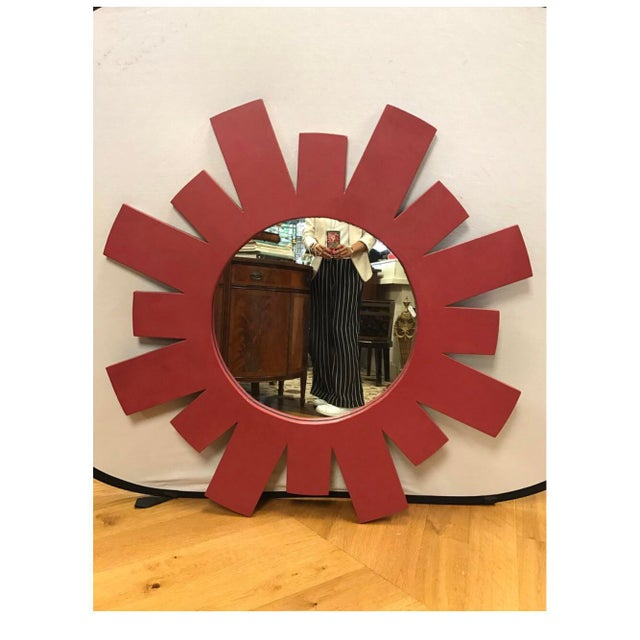 Hand-carved architectural Mid-Century Modern large red starburst style wall mirror guaranteed to brighten up any space....