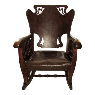 Art Nouveau Carved Wood and Leather Rocking Chair For Sale