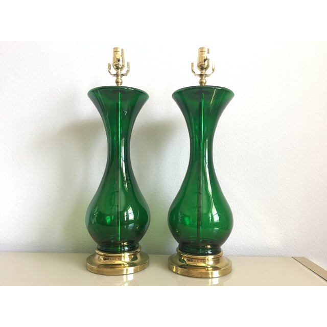 Stunning pair of 1940s statement lamps by Rembrandt featuring blown glass inner stems and curvy emerald glass bodies...
