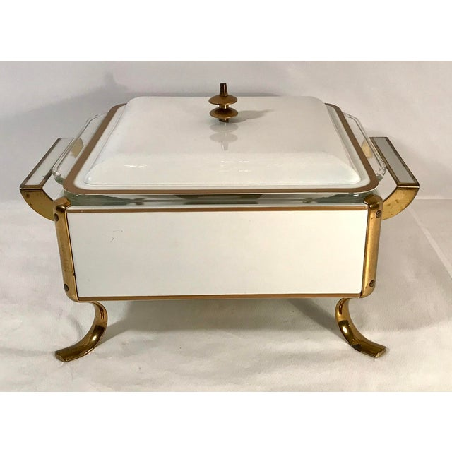 Beautiful space age look to this Mid Century all metal ivory and gold Casserole Warmer Stand. There is a place for a...