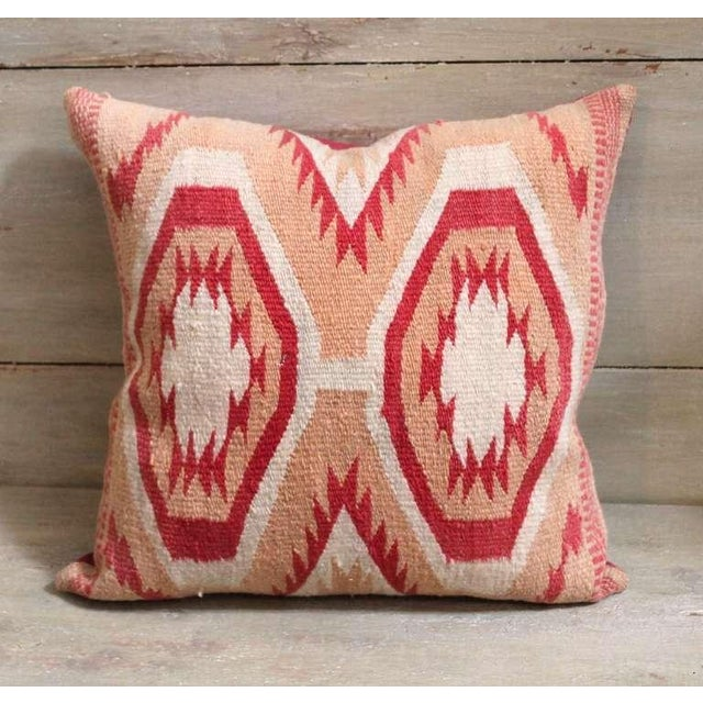 This pillow was constructed from a wide ruins Navajo weaving and dates to the early 1920s. The weaving shows an intricate...