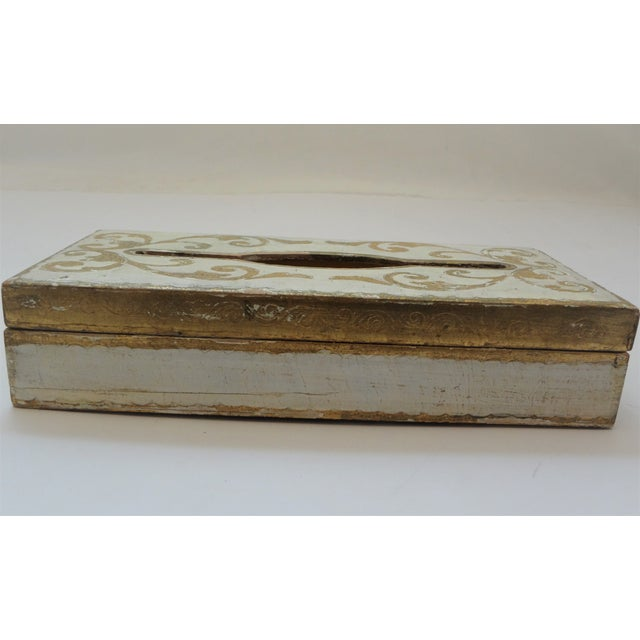 A shabby chic gold gilt tissue box with scroll work on an antique white base. Chips and wear lend to the shabby feel, gold...