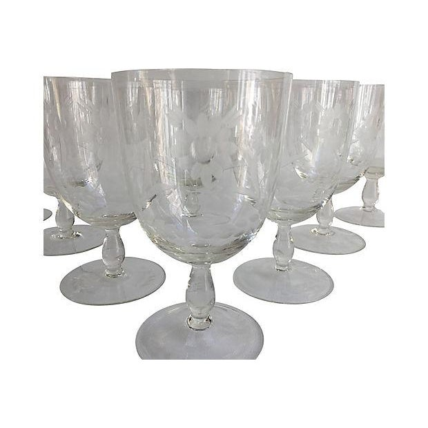 Set of eight 1920s cut-crystal stemmed goblets with large floral and leaf motif. Unmarked. Condition: Excellent Dims: 3.45...
