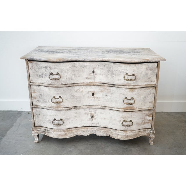 This is a nicely sized chest of three drawers in the Louis XV style with serpentine front and lack of a molding and...