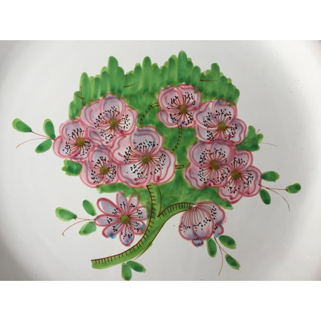 This charming hand-painted Italian faience round platter features pink geraniums and chartreuse green leaves with a pink...