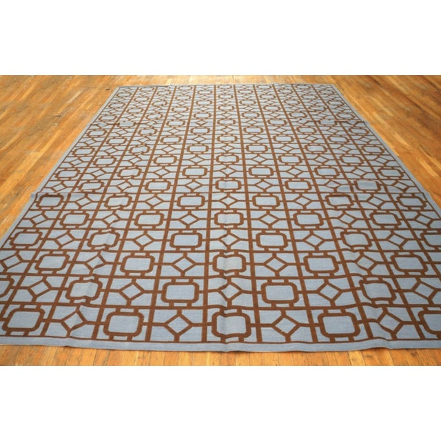 Needlepoint Rug with a blue background.