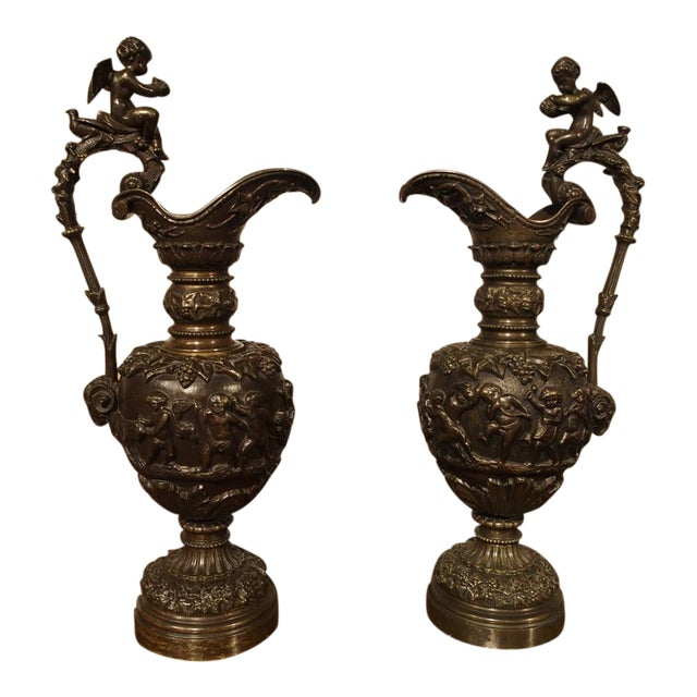 A Pair of Antique French Patinated Bronze Ewers with Bacchanalian Scenes For Sale