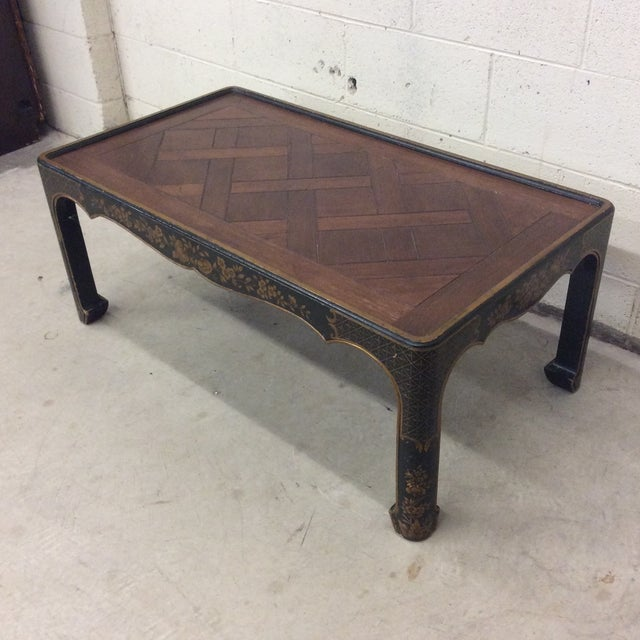 The fabulous Baker Fine Furniture coffee table in an Asian style Ming leg and parquetry herringbone pattern wood top. Base...