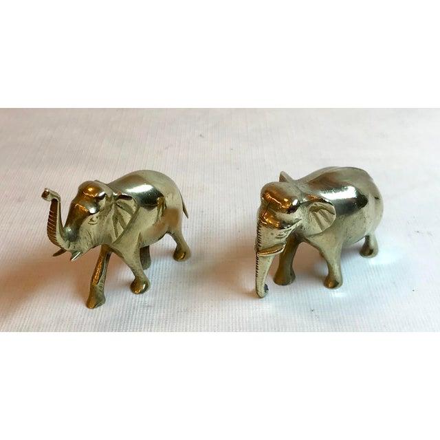 A pair of petite brass elephants.