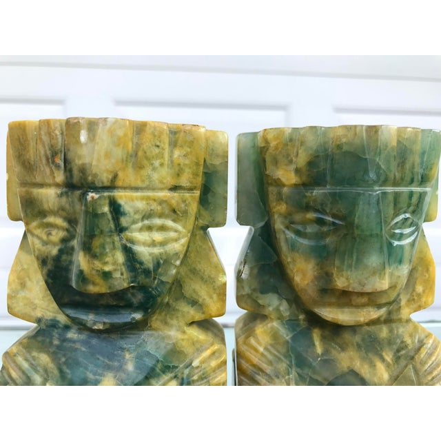 Carved stone tribal figure bookends. The material is assumed to be onyx.