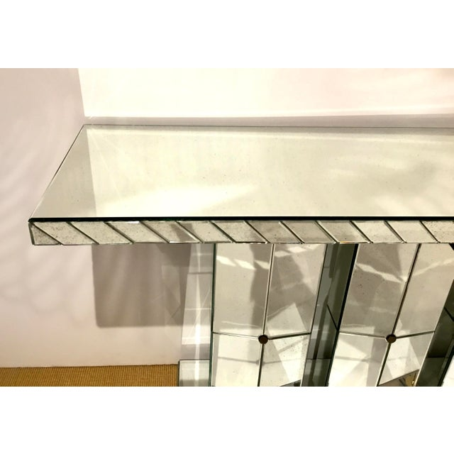 Original retail $5800, elegant Maitland Smith modern mirrored console table, antique mirror panels, showroom floor sample