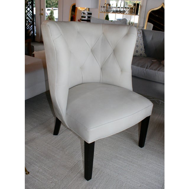 "As comfortable as it is beautiful, in soft matte leather. Great as a host & hostess or lounge chair. 32""w x 38""h x 32""d..."