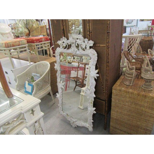 "Wooden Carved Flower Vine Mirror. It measures 56""H x 31""Wx2""D."