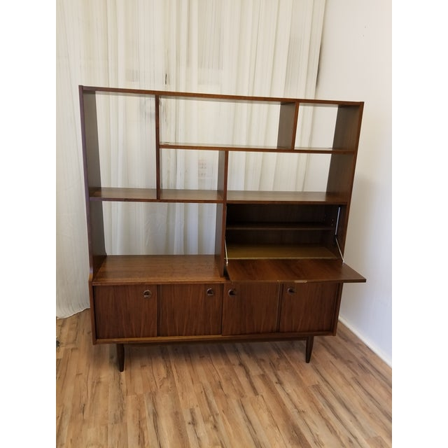 Authentic mid-century bookcase with bronze hardware. Made out of walnut wood, it's in good original condition, I only...
