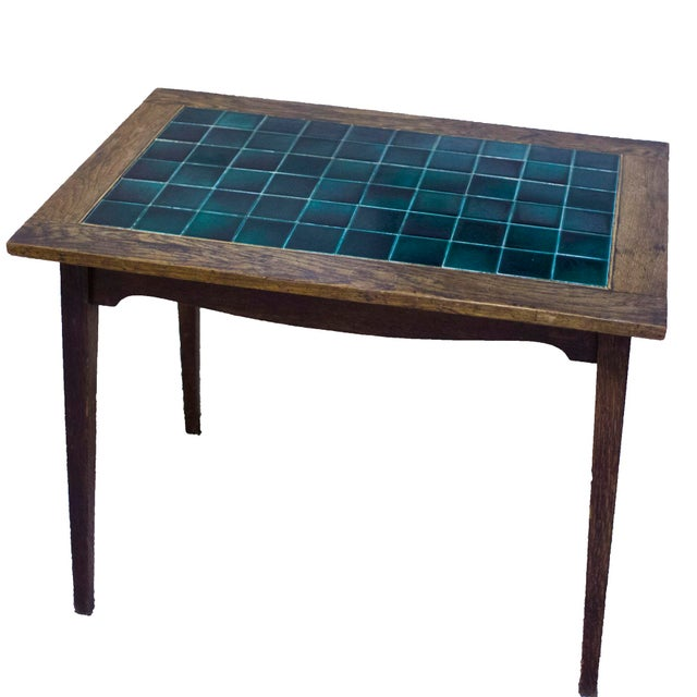 Antique English pub table with a wooden base and a wooden and dark green tile top. The table was originally from a pub in...