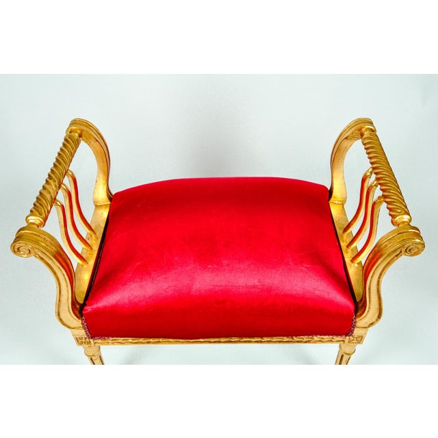 Vintage giltwood bench with red cotton velvet upholstery.