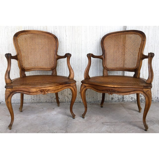 Louis XV carved Provincial Fauteil's with caned seats and backrests with velvet upholstered rigid cushions-seats, carved...