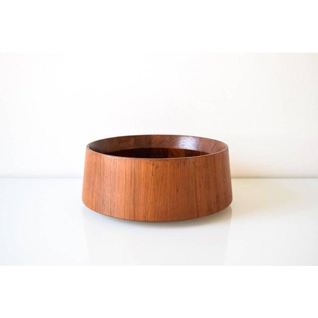 This large vintage mid century modern Dansk teak wood fruit bowl is circa 1960. It features a simple, elegant design with...