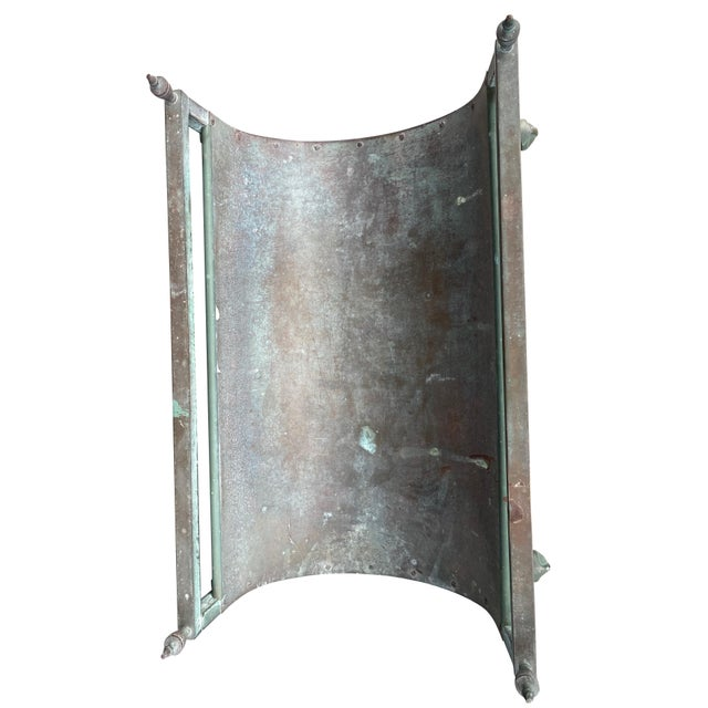 With oxidized finish, heavy guage and basket form with urn form finials and paw feet.