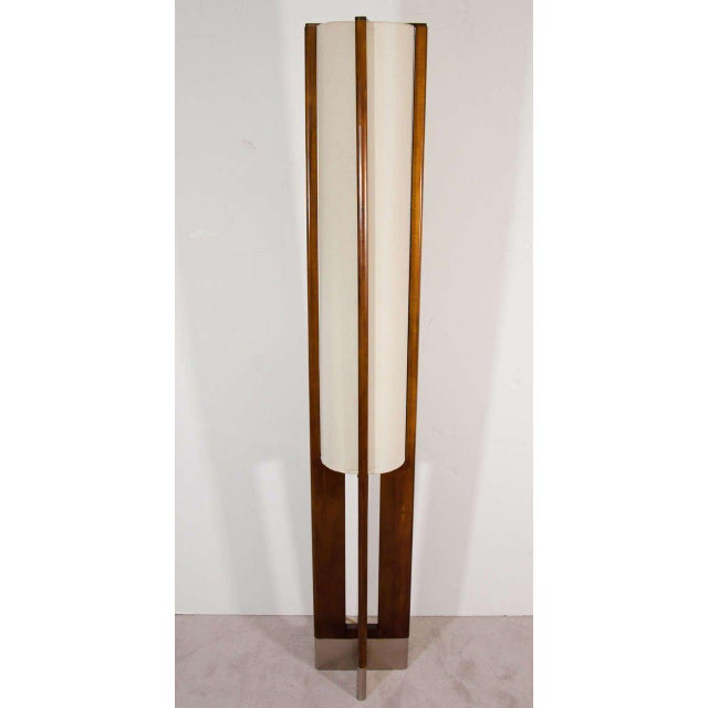 A great pair of Danish modern walnut floor lamps with linen shades and stainless steel X-base.