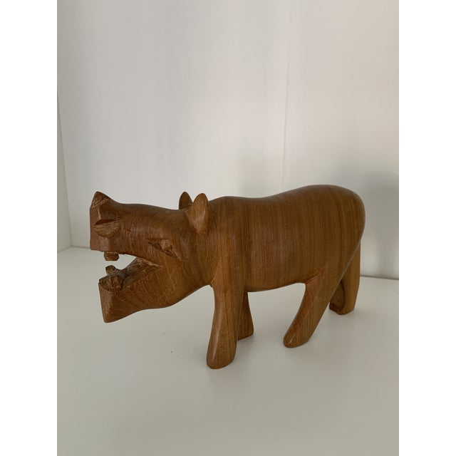 Hand carved wooden hippo with endless possibilities.