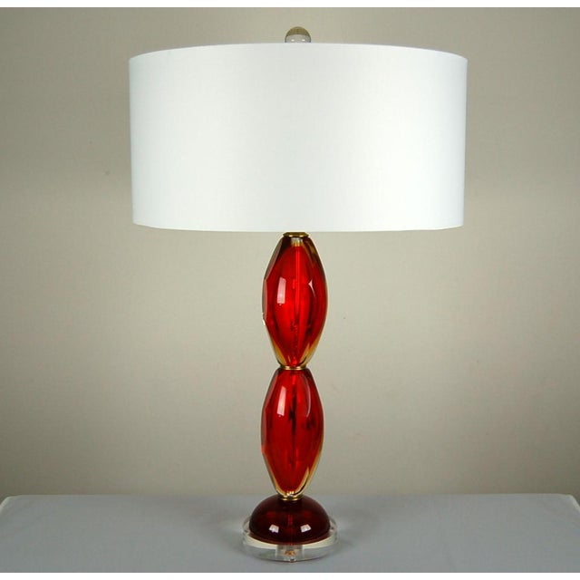 Elegant Murano glass table lamps in the Sommerso style. A thick inner core of LIPSTICK RED Venetian glass is surrounded by...