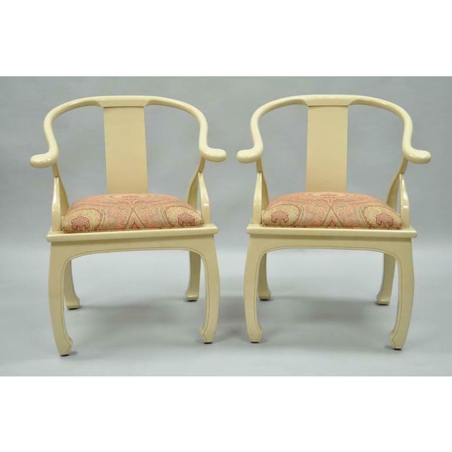 Quality pair of vintage decorator cream lacquered Asian inspired lounge chairs. Items feature solid wood frames, cream...