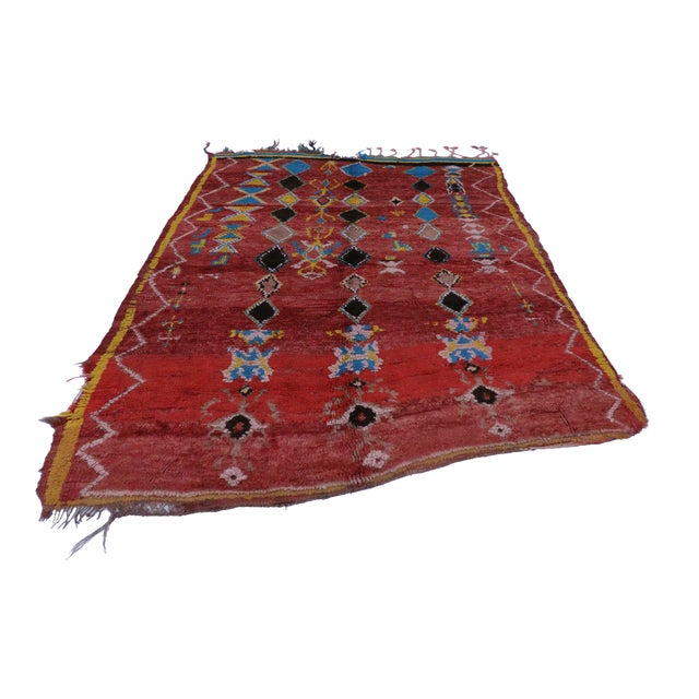 Full of character and primitive charm, this vintage Berber Moroccan rug features an allover tribal design in a vibrant...